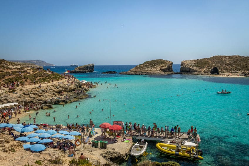 People at the Blue Lagoon in Comino Island - Gozo, Malta