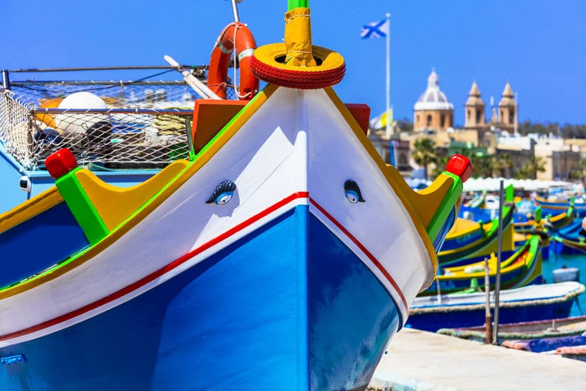 traditional colorful fishing boats luzzu in Malta